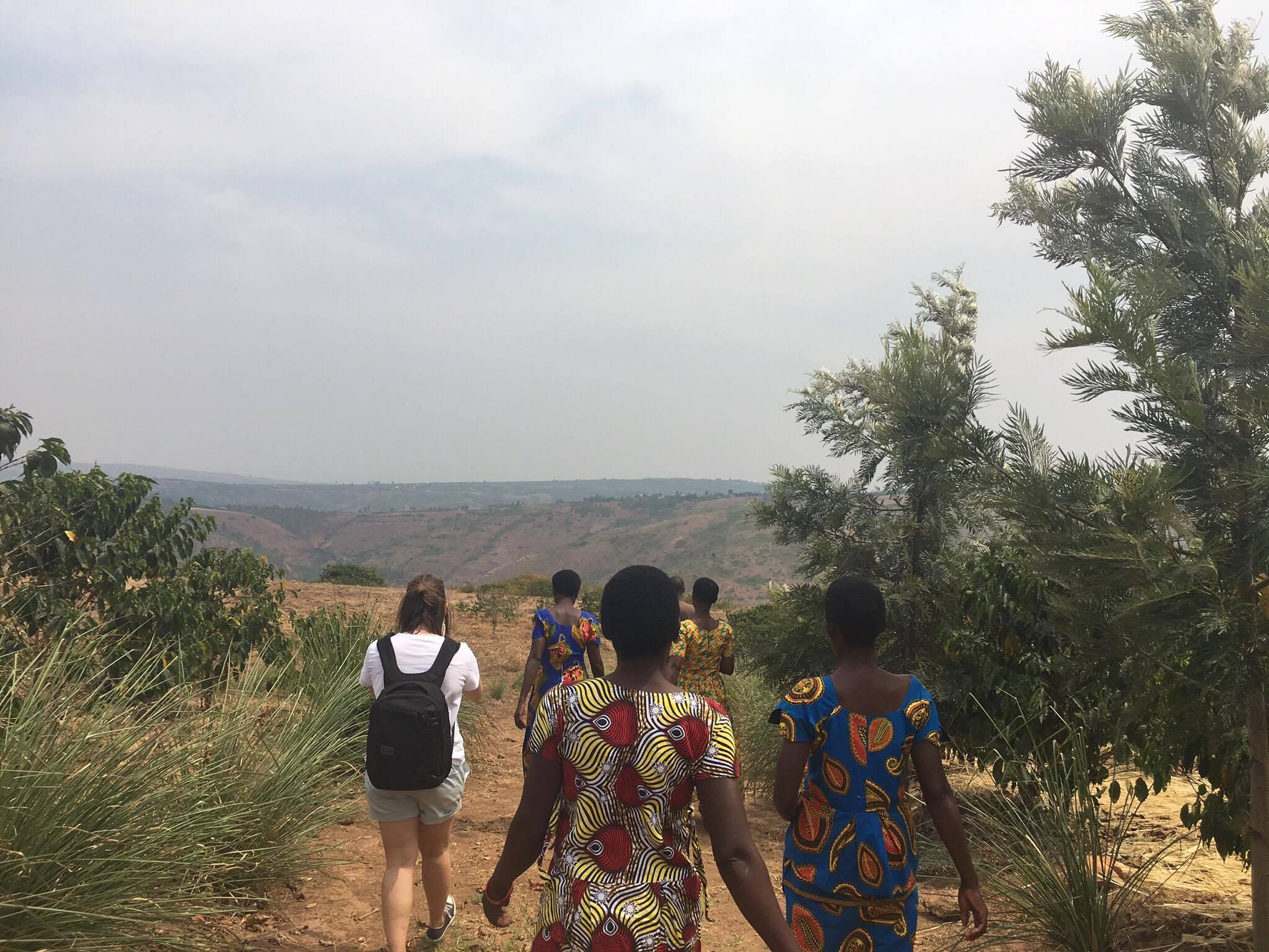 Twongere Umusaruro Walking to the farm Twongere Umusaruro Seeds Rwanda